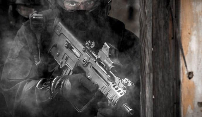 Soldier holding Tavor x95